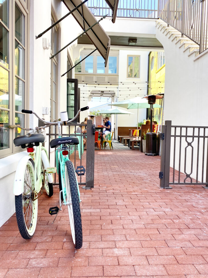 Two bikes parked near gate in beaches town center