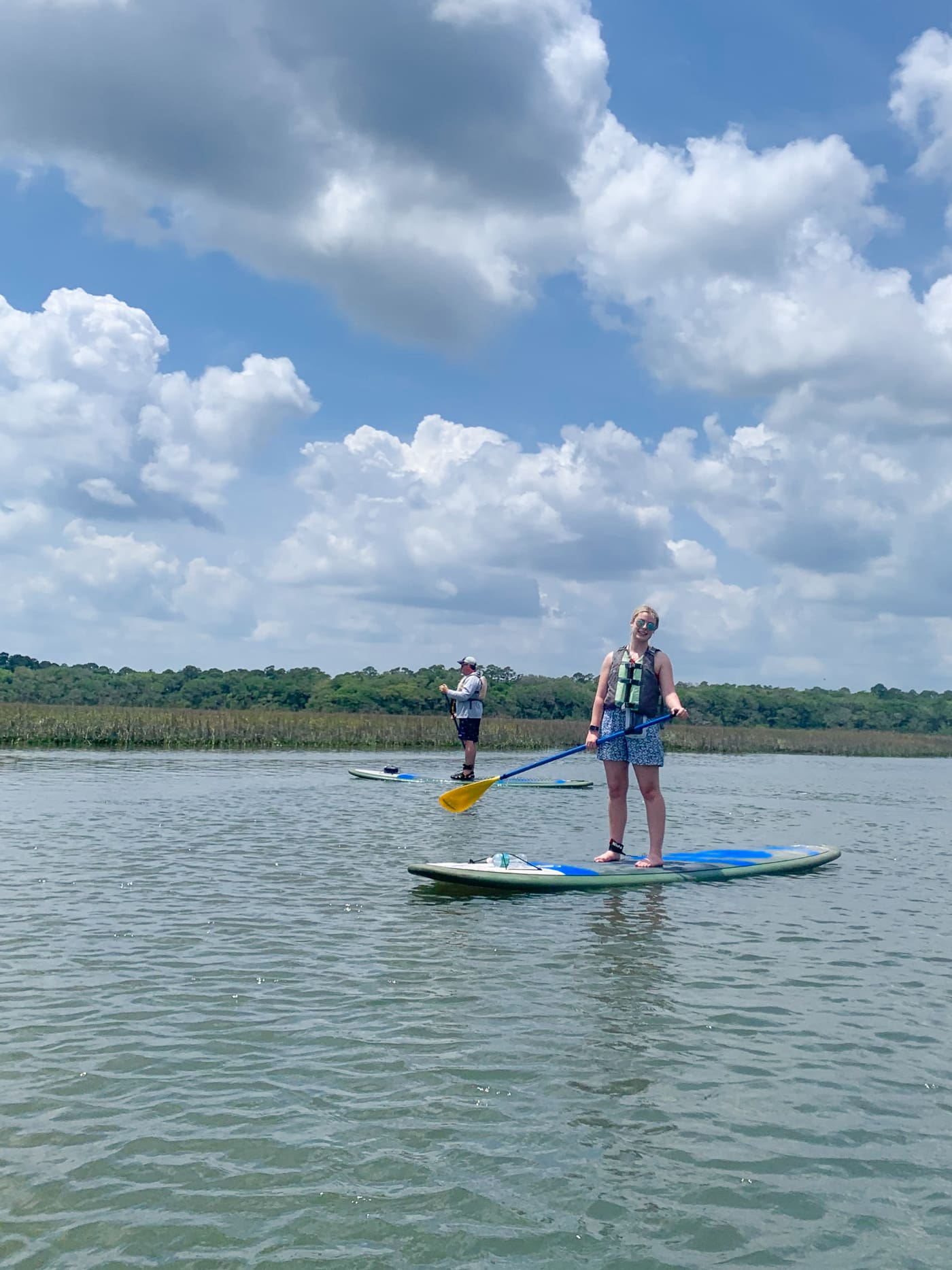 two people on paddleboards in water