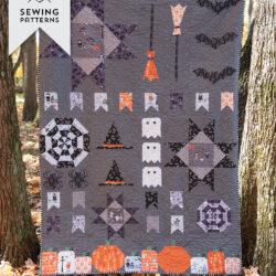 halloween quilt hanging outdoors.
