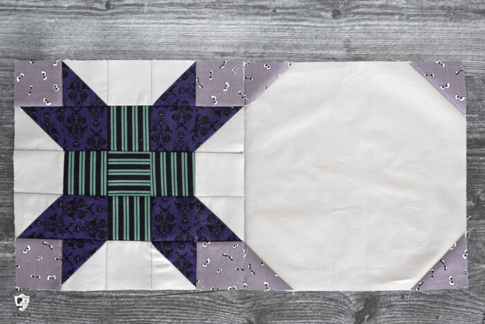 two gray quilt blocks on wood table