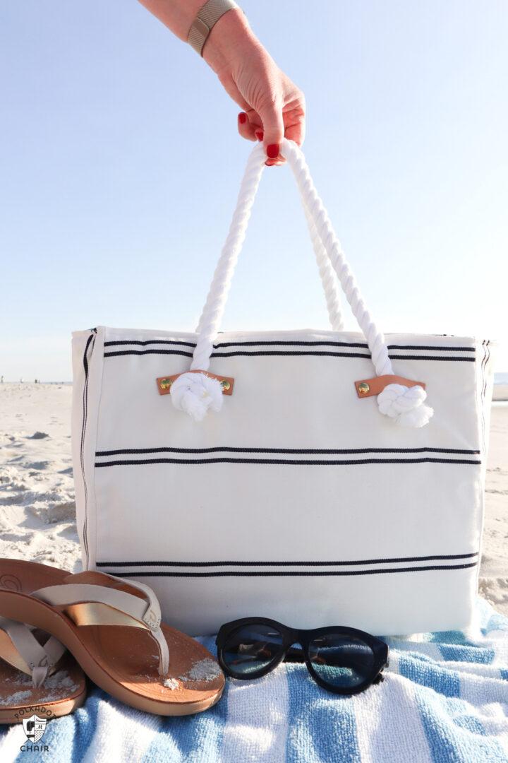 white and blue beach bag on beach