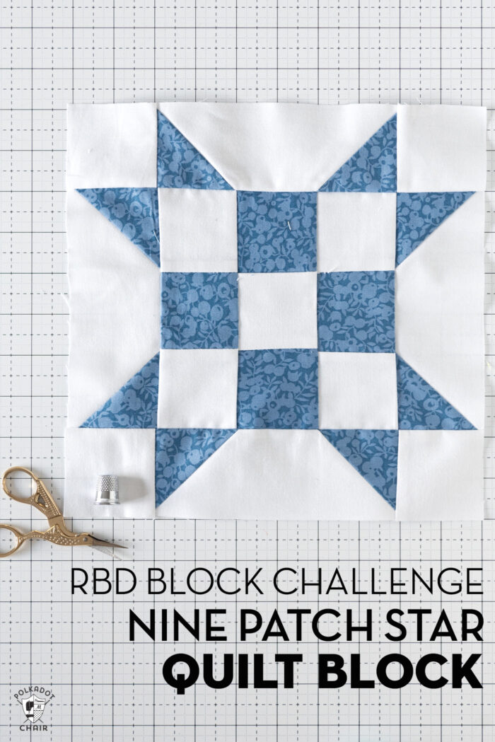 blue and white geometric quilt block on white cutting mat