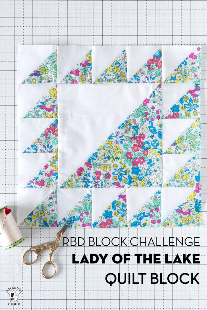 blue and white floral quilt block on white cutting mat