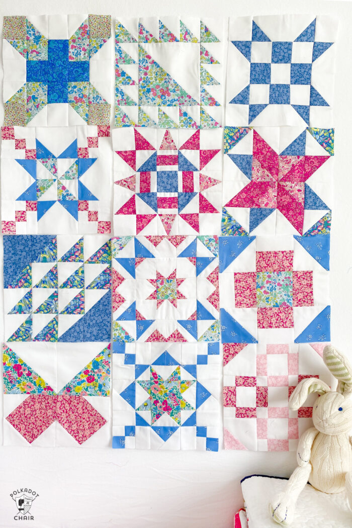 pink, white and blue quilt blocks on white wall