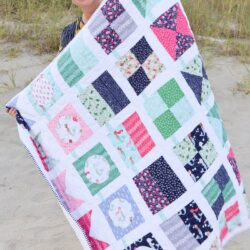 seas the day quilt pattern being held by woman