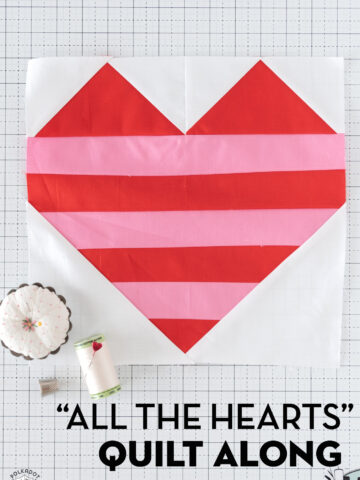 red, white and pink quilt block on cutting mat