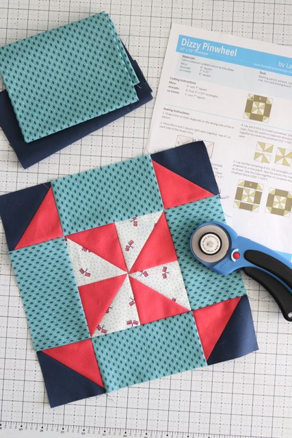 red, blue and turquoise quilt block with tools