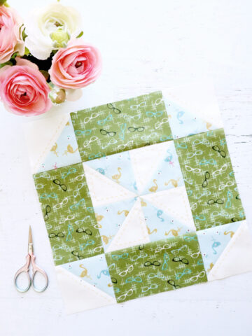 green and blue quilt block on white cutting mat