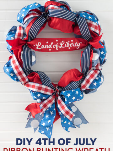 red, white and blue ribbon wreath on white wall