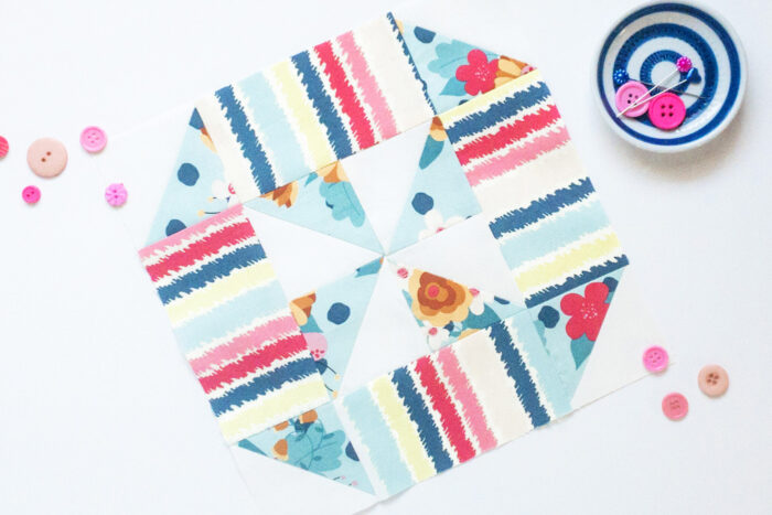 colorful quilt block on white table
