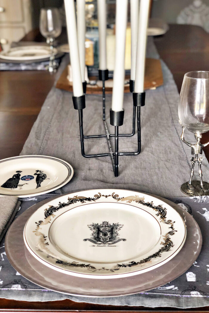 halloween table setting with gray table runner and white plates