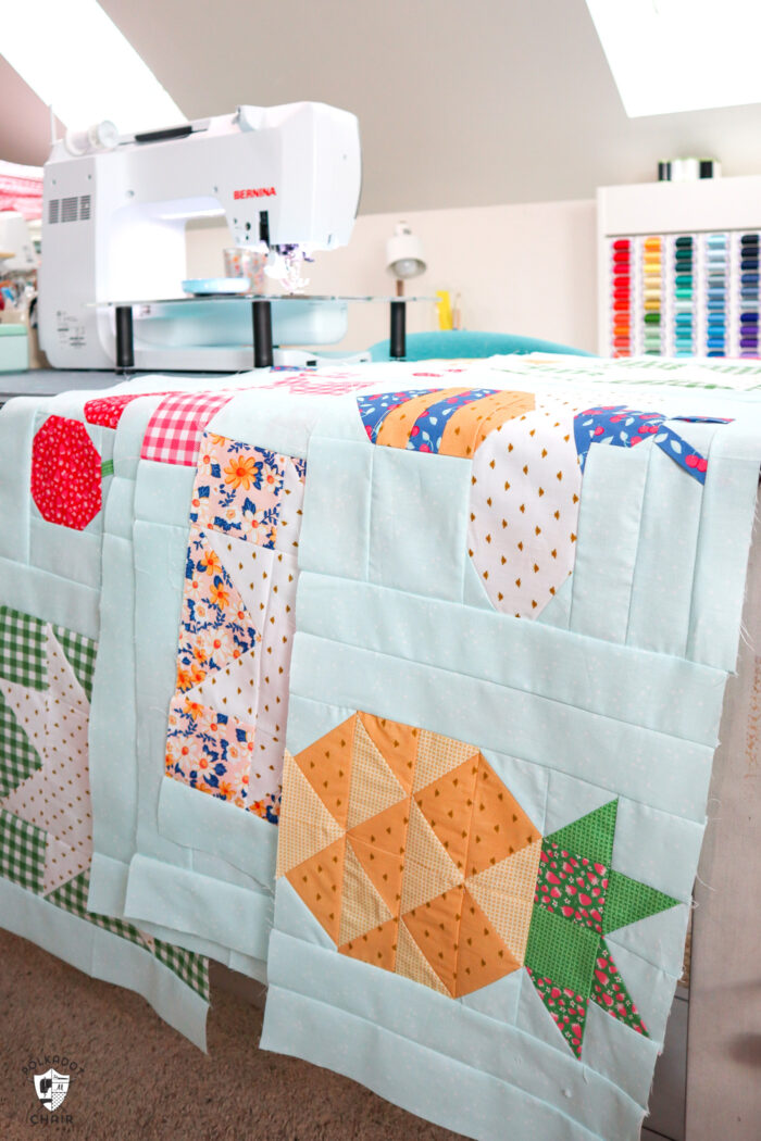rows of quilt blocks on sewing machine table