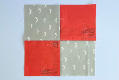 diagram of red and gray quilt block construction