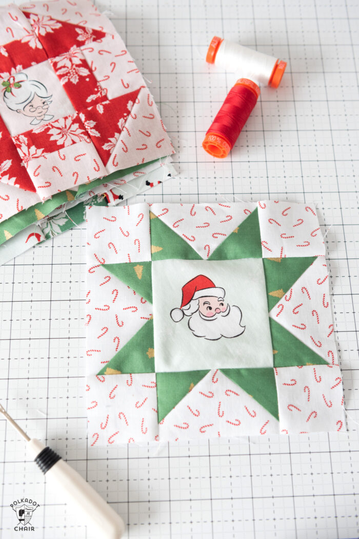 red and green christmas quilt block on white cutting mat