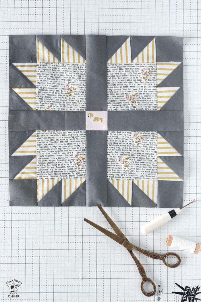 gray and yellow quilt block on white cutting mat