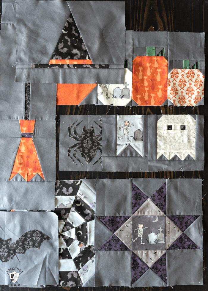 gray, orange and black quilt blocks on black table