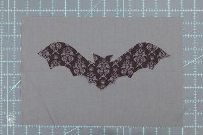bat shape on gray fabric
