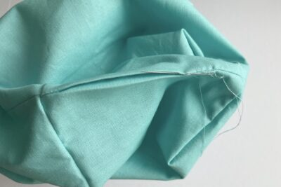 blue fabrics, wrong side out pinned together