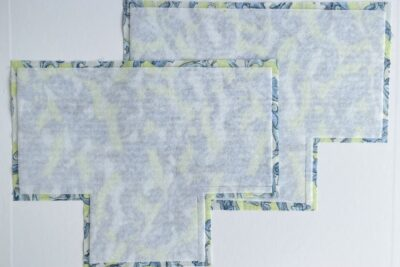 2 pieces of blue fabric cut in a T shape