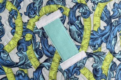 close up of applique of spool of thread