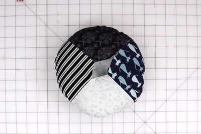 fabric circles on white cutting mat
