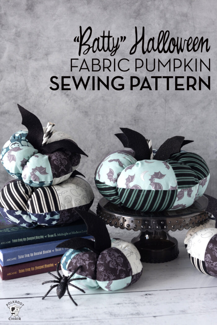 Stack of blue and gray fabric pumpkins in front of gray wall.