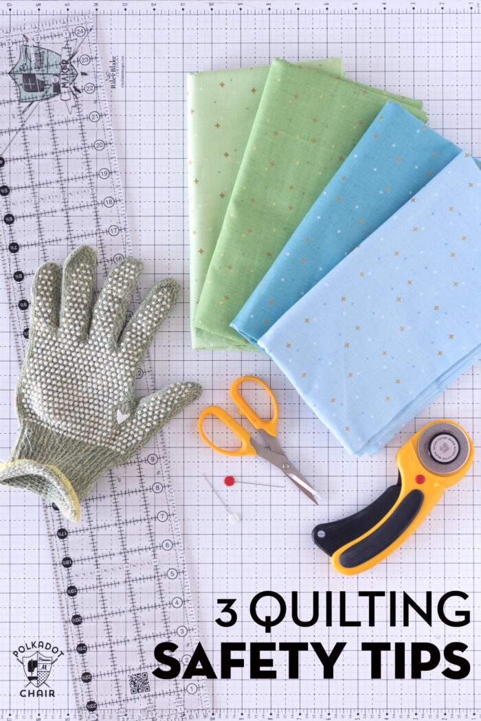 hand with cut glove on white cutting mat with quilt ruler and rotary cutter