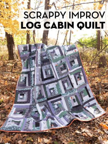 purple, gray and black scrappy quilt hanging on fence outside in the Fall